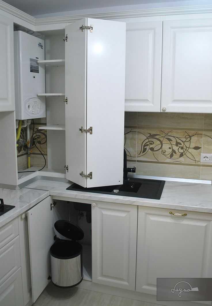 Красивому дизайну система отопления не помеха: как спрятать газовый котёл на кухне?